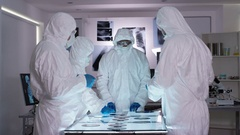 4K Funny scientist dancing, working with colleagues in sterile lab Stock Footage