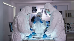 4K Scientific research team wearing full body suits in sterile lab Stock Footage