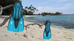 Snorkel vacation travel holidays concept with snorkeling fins on beach Stock Footage