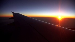 Airplane flying over clouds Stock Footage