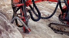 Rock driller drilling the ground Stock Footage