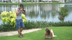 Beautiful model posing for male photographer Stock Footage
