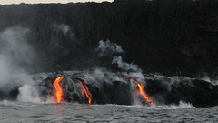 Hawaii Lava flowing into the ocean from volcano lava eruption on Big Island Stock Footage
