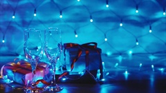 Champagne pouring from the bottle in couple of wineglasses christmas scene Stock Footage