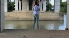 Beautiful girl dancing under the bridge Stock Footage