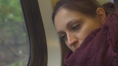 Thoughtful Girl On the Train: Looks Outside, falls Asleep Stock Footage