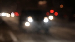 Urban transport traffic in the evening during a snowfall Stock Footage