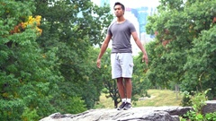 Man doing martial art exercises at Central Park Stock Footage