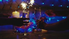Couple toasting with champagne christmas scene and sparkler Stock Footage