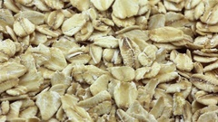 Rotating rolled oats flakes closeup Stock Footage