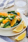 Asian style healthy spinach, avocado and orange salad, vertical Stock Photos