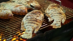 Charcoal grilled fish, asian street food at night street market Stock Footage