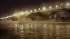 Road bridge and rising mist over river Yenisei in the night light, Krasnoyarsk Stock Footage