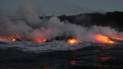 Lava running in the ocean from volcanic lava eruption on Big Island Hawaii Stock Footage