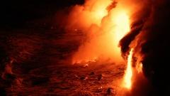 Lava reaching ocean from lava stream on Big Island Hawaii volcano eruption Stock Footage