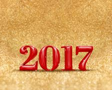 Happy new year 2017 red color at golden sparkling glitter Stock Photos