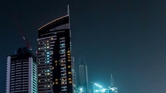 View of the towers in the district Dubai Marina at night. Timelapse Stock Footage