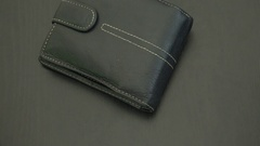 Black leather wallet with Russian rubles and dollars Stock Footage