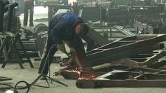 Welder Industrial automotive part in factory Stock Footage
