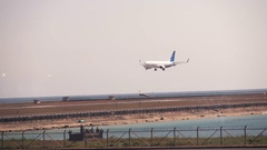 Airplane landing on airport in Bali, Indonesia Stock Footage