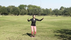 Slow motion young woman jump roping in a park Stock Footage