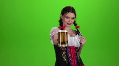 Girl Oktoberfest sexually attracts and licks his lips. Green screen Stock Footage