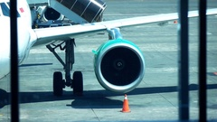 Plane standing still at terminal Stock Footage