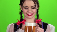 Girl drinks beer and sexy licked. Green screen. Slow motion Stock Footage