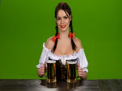 Lady in Bavarian costume offers drink two glasses of beer. Green screen Stock Footage