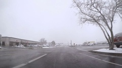 POV point of view - Time-lapse.  Driving in first snow storm of the season. Stock Footage