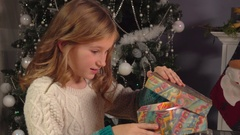 Little girl opens new year's gift Stock Footage