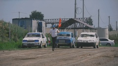 The judge ran to the flag before the start of the race Stock Footage