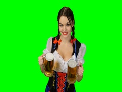 Girl in Bavarian costume with beer glasses in their hands. Green screen Stock Footage