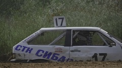 Several rally cars passing on the road Stock Footage
