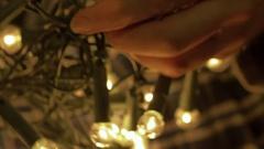 Untangling Christmas Lights Stock Footage