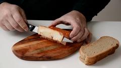 Paprika lard cut by slices on a wooden board Stock Footage