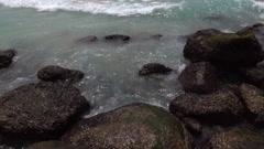 Slow motion, 120fps, of sea splash between boulders Stock Footage