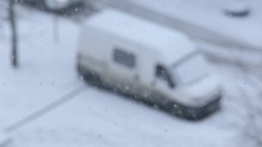 Top view of blurry white dirty minivan on parking covered with snow Stock Footage