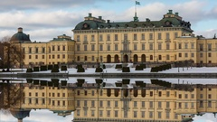 Drottningholm Palace in the winter with mirror image in the water. Stock Footage
