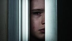 4K Thriller Child Eye Looking through Door Hole Gap Stock Footage