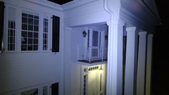Aerial of House with white pillars at night Arkistovideo
