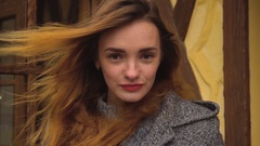 The wind blows through hair for a girl with red lips Stock Footage