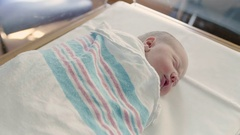 Static Overhead Shot of Dreaming Newborn Baby Sleeping Peaceful in Hospital Stock Footage