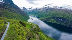 Aerial footage Geiranger fjord, Norway. It is a 15-kilometre (9.3 mi) long branc Stock Footage
