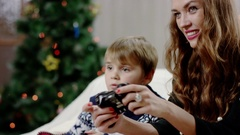 Woman and boy playing on playstation Stock Footage