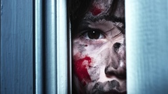 4K Thriller Child Bloody Eye Looking through Door Hole Gap, dolly fast Arkistovideo