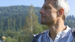 A man breathes morning air in mountains on a run Stock Footage