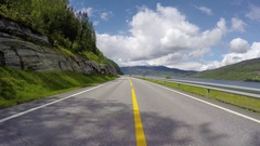 Driving a Car on a Mountain road in Norway with high snow wall Stock Footage