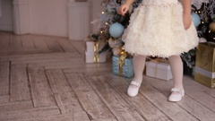 Little girl three years old in a white dress dancing Stock Footage