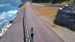 Woman jogging outdoors. Norwegian fjord. Stock Footage